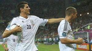Germany's Podolski celebrates with Gomez after scoring a goal against Denmark during their Group B Euro 2012 soccer match at the New Lviv stadium in Lviv
