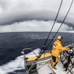 February 26, 2015. Leg 4 to Auckland onboard Abu Dhabi Ocean Racing. Day 18.  Riding the front downdraft from a massive wall cloud, Ian Walker drives Azzam to windward around Dongfeng 4 nm away en route to Auckland.