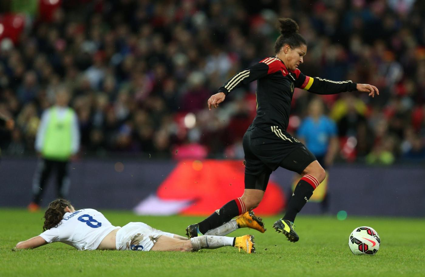 England's Karen Carney and Germany's Celia Sasic during the International Friendly at Wembley Stadium, London. PRESS ASSOCIATION Photo. Picture date: Sunday November 23, 2014. See PA story SOCCER England Women. Photo credit should read: Mike Egerton/PA Wire. RESTRICTIONS: Editorial use only. Maximum 45 images during a match. No video emulation or promotion as 'live'. No use in games, competitions, merchandise, betting or single club/player services. No use with unofficial audio, video, data, fixtures or club/league logos.