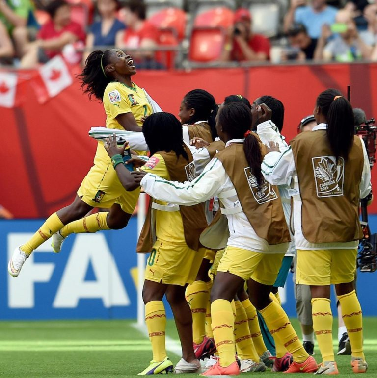 (150609) -- VANCOUVER, June 9, 2015 (Xinhua) -- Gabrielle Onguene (1st L) of Cameroon celebrates scoring during the group C match between Cameroon and Ecuador at the 2015 FIFA Women's World Cup in Vancouver, Canada, June 8, 2015. (Xinhua/Wang Yuguo)