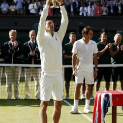 File photo dated 06-07-2014 of Serbia's Novak Djokovic celebrates defeating Switzerland's Roger Federer in the Mens' Singles Final during day fourteen of the Wimbledon Championships at the All England Lawn Tennis and Croquet Club, Wimbledon. PRESS ASSOCIATION Photo. Issue date: Monda June 22, 2015. Press Association Sport looks at the top prospects to lift the trophy this year. See PA story WIMBLEDON Men Overview. Photo credit should read Jonathan Brady/PA Wire. Wimbledon, le immagini che hanno fatto storiaLaPresse  -- Only Italy