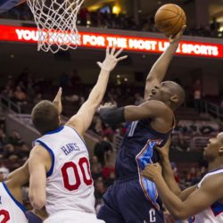 February 9, 2013: Charlotte Bobcats power forward Bismack Biyombo (0) puts up the shot as he is being guard by Philadelphia 76ers center Spencer Hawes (00), power forward Lavoy Allen (50), and small forward Evan Turner (12) during the NBA game between the Charlotte Bobcats and the Philadelphia 76ers at the Wells Fargo Center in Philadelphia, Pennsylvania. The Philadelphia 76ers beat the Charlotte Bobcats, 87-76. LaPresse  -- Only Italy