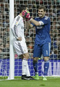 Real Madrid's captain Iker Casillas (R) greets Portuguese Cristiano Ronaldo (L) during the Spanish Liga Primera Division soccer match against Celta played at Santiago bernabeu stadium, in Madrid, Spain, 06 December 2014. EFE/Angel Diaz