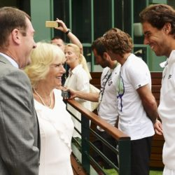 Britain's Camilla, Duchess of Cornwall stands with AELTC Chairman Philip Brook, as she chats with Rafael Nadal of Spain, during her visit to the Wimbledon Tennis Championships in London, Britain July 2, 2015.  REUTERS/Dominic Lipinski/Pool