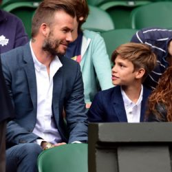 David Beckham and son Romeo wait for the Andy Murray match on centre court during day Nine of the Wimbledon Championships at the All England Lawn Tennis and Croquet Club, Wimbledon. PRESS ASSOCIATION Photo. Picture date: Wednesday July 8, 2015.  See PA Story TENNIS Wimbledon. Photo credit should read: Dominic Lipinski/PA Wire. RESTRICTIONS: Editorial use only. No commercial use without prior written consent of the AELTC. Still image use only - no moving images to emulate broadcast. No superimposing or removal of sponsor/ad logos. Call +44 (0)1158 447447 for further information. Lapresse Only italyDavid Beckham e figlio Romeo assistono in tribuna al Torneo di Wimbledon
