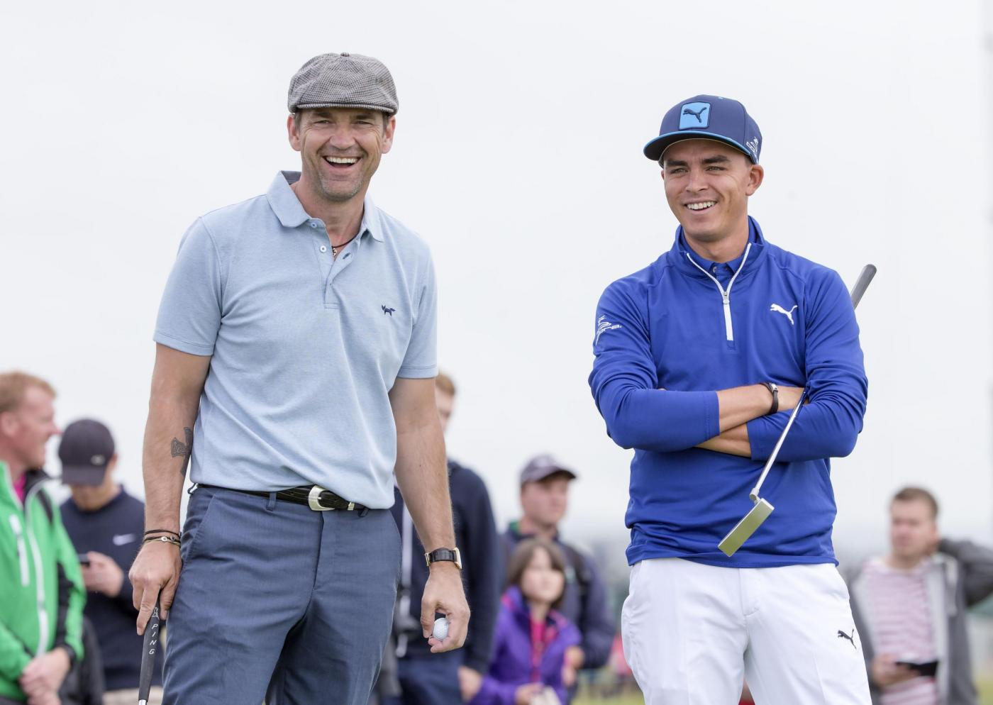 USA's Ricky Fowler (right) shares a laugh with actor Dougray Scott on the 10th tee during a preview day ahead of the Scottish Open at Gullane Golf Club, East Lothian. PRESS ASSOCIATION Photo. Picture date: Wednesday July 8, 2015. See PA story GOLF Gullane. Photo credit should read: Kenny Smith/PA Wire. RESTRICTIONS: Editorial use only. No commercial use. No false commercial association. No video emulation. No manipulation of images.