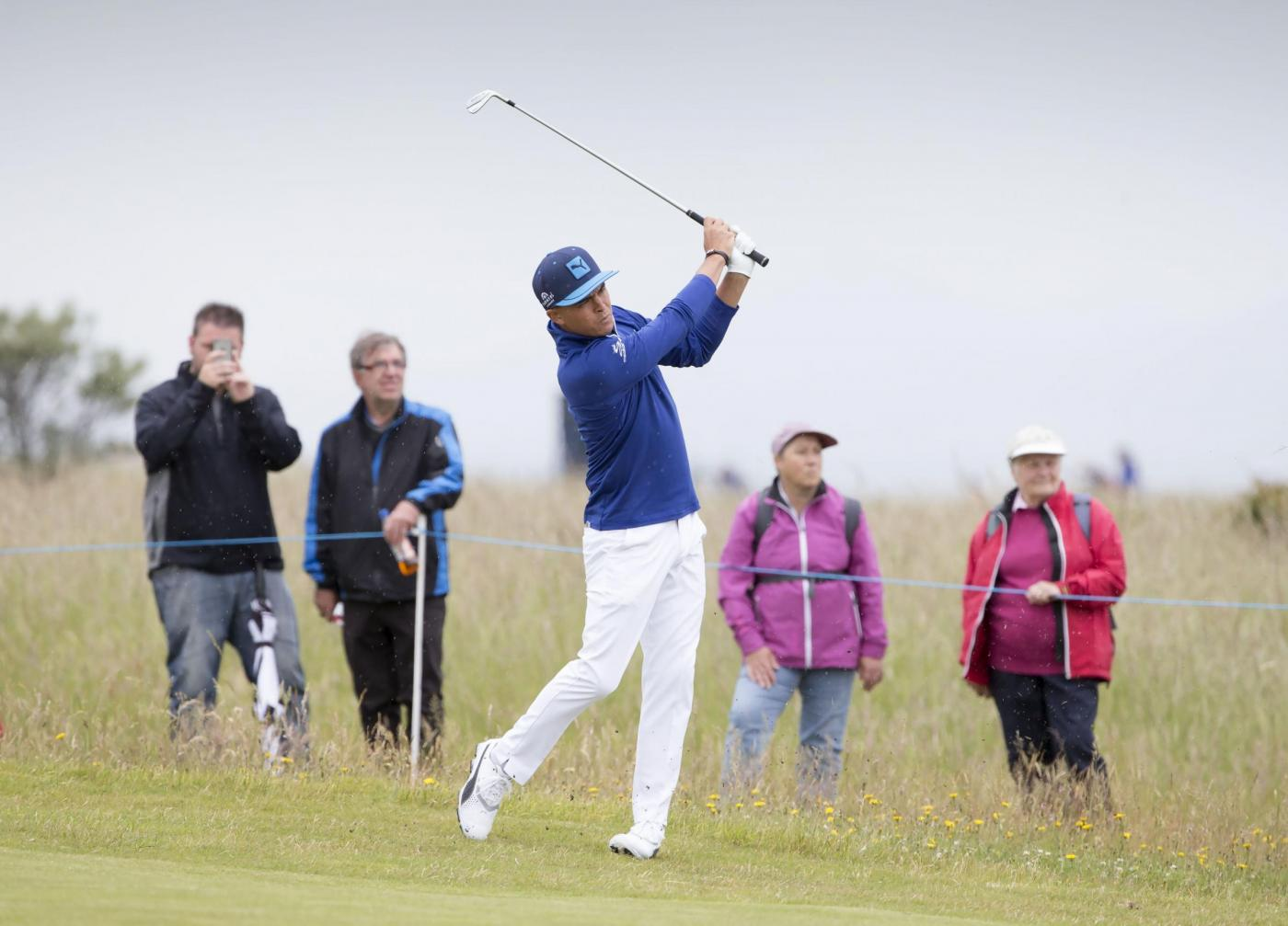 USA's Ricky Fowler plays his approach to the 10th green during a preview day ahead of the Scottish Open at Gullane Golf Club, East Lothian. PRESS ASSOCIATION Photo. Picture date: Wednesday July 8, 2015. See PA story GOLF Gullane. Photo credit should read: Kenny Smith/PA Wire. RESTRICTIONS: Editorial use only. No commercial use. No false commercial association. No video emulation. No manipulation of images.