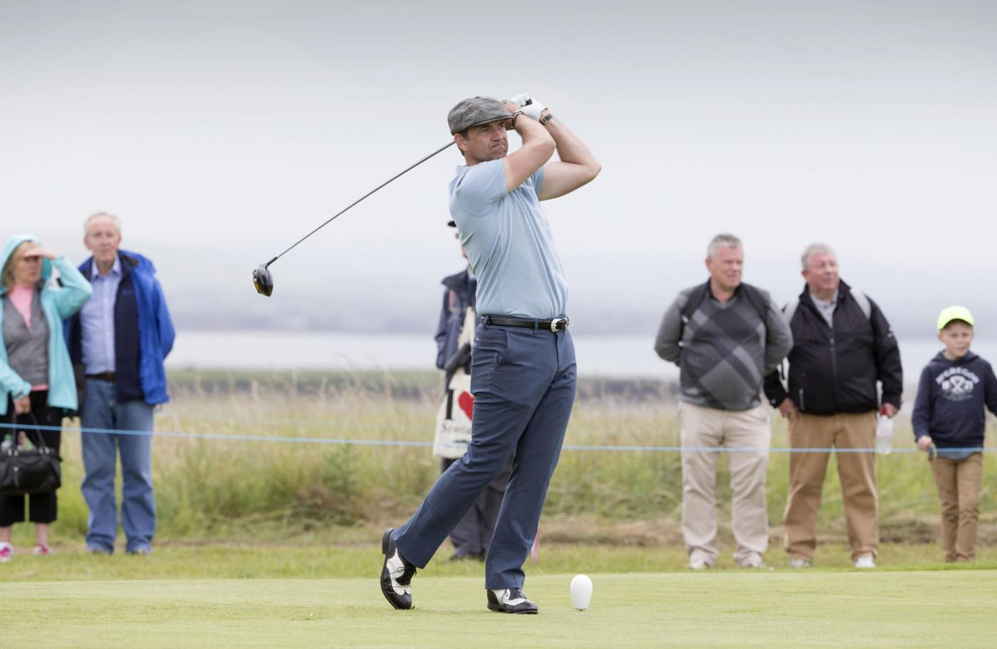 Scottish actor Dougray Scott tees off at the 10th hole in the pro am event during a preview day ahead of the Scottish Open at Gullane Golf Club, East Lothian. PRESS ASSOCIATION Photo. Picture date: Wednesday July 8, 2015. See PA story GOLF Gullane. Photo credit should read: Kenny Smith/PA Wire. RESTRICTIONS: Editorial use only. No commercial use. No false commercial association. No video emulation. No manipulation of images.