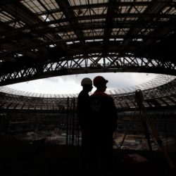 (150710) -- MOSCOW, July 10, 2015 (Xinhua) -- Photo taken on July 9, 2015 shows staff work at the Luzhniki stadium under reconstruction in Moscow, Russia. Russia will host the FIFA World Cup soccer tournament in 2018. (Xinhua/Li Ming)