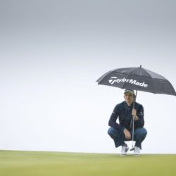 England's Justin Rose tries to keep dry as he lines up a putt at the 3rd hole during day two of the Scottish Open at Gullane Golf Club, East Lothian. PRESS ASSOCIATION Photo. Picture date: Friday July 10, 2015. See PA story GOLF Gullane. Photo credit should read: Kenny Smith/PA Wire. RESTRICTIONS: Editorial use only. No commercial use. No false commercial association. No video emulation. No manipulation of images.