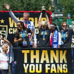 Jul 10, 2015; New York, NY, USA; Carli Lloyd (left), Megan Rapinoe (center), New York City mayor Bill De Blasio (rear) and his wife Chirlane McCray (second from right), and USA head coach Jill Ellis (right) make their way up Broadway in a ticker tape parade. Mandatory Credit: Robert Deutsch-USA TODAY Sports