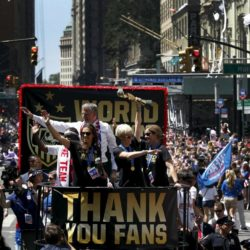 U.S. women's soccer player Megan Rapinoe (C) holds the Wold Cup trophy as she rides a float with teammate Carli Lloyd (L), Coach Jill Ellis (R) and New York City Mayor Bill de Blasio during the ticker tape parade up Broadway in lower Manhattan to celebrate their World Cup final win over Japan in New York, July 10, 2015.  REUTERS/Mike Segar