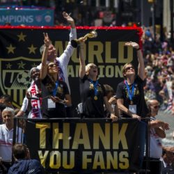 "U.S. women's soccer player Megan Rapinoe (C) holds the Wold Cup trophy as she rides a float with team mates and Coach Jill Ellis (R) and New York City Mayor Bill de Blasio (back) during the ticker tape parade up Broadway in lower Manhattan to celebrate their World Cup final win over Japan in New York, July 10, 2015. Screams and a blizzard of confetti cheered the World Cup winning U.S. women's soccer players as they rolled up New York City's ""Canyon of Heroes"" on Friday in the first ticker-tape parade honoring a women's sports team.  REUTERS/Mike Segar"