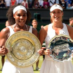 Serena Williams and Garbine Muguruza (right) with their trophies after the Ladies' Singles Final during day Twelve of the Wimbledon Championships at the All England Lawn Tennis and Croquet Club, Wimbledon. PRESS ASSOCIATION Photo. Picture date: Saturday July 11, 2015.  See PA Story TENNIS Wimbledon. Photo credit should read: Adam Davy/PA Wire. RESTRICTIONS: Editorial use only. No commercial use without prior written consent of the AELTC. Still image use only - no moving images to emulate broadcast. No superimposing or removal of sponsor/ad logos. Call +44 (0)1158 447447 for further information.