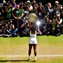 Serena Williams celebrates Trophy following her victory in the ladies singles final on day Twelve of the Wimbledon Championships at the All England Lawn Tennis and Croquet Club, Wimbledon. PRESS ASSOCIATION Photo. Picture date: Saturday July 11, 2015.  See PA Story TENNIS Wimbledon. Photo credit should read: Dominic Lipinski/PA Wire. RESTRICTIONS: Editorial use only. No commercial use without prior written consent of the AELTC. Still image use only - no moving images to emulate broadcast. No superimposing or removal of sponsor/ad logos. Call +44 (0)1158 447447 for further information.