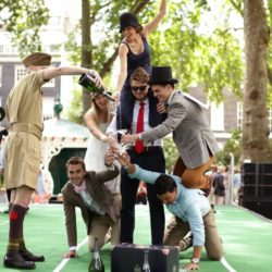People taking part in the Champagne Charlie Pyramid of Dextrous Dandies contest at the Chap Olympiad 2015 in Bedford Square, Bloomsbury, London. The eccentric event  describes itself as a celebration of Britain's sporting ineptitude where sensational cravats take precedence over sweaty lycra. PRESS ASSOCIATION Photo. Picture date: Saturday July 11, 2015. Photo credit should read: Yui Mok/PA Wire