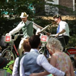 People riding 'Boris Bikes' take part in the Umbrella Jousting contest at the Chap Olympiad 2015 in Bedford Square, Bloomsbury, London. The eccentric event  describes itself as a celebration of Britain's sporting ineptitude where sensational cravats take precedence over sweaty lycra. PRESS ASSOCIATION Photo. Picture date: Saturday July 11, 2015. Photo credit should read: Yui Mok/PA Wire