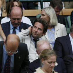 Actor Bradley Cooper (C) on Centre Court at the Wimbledon Tennis Championships in London, July 12, 2015.                                                    REUTERS/Stefan Wermuth