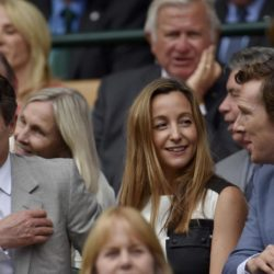 Actor's Benedict Cumberbatch (R) and Hugh Grant (L) on Centre Court at the Wimbledon Tennis Championships in London, July 12, 2015.                                                     REUTERS/Toby Melville