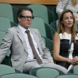 Actor Hugh Grant on Centre Court at the Wimbledon Tennis Championships in London, July 12, 2015.                                                    REUTERS/Stefan Wermuth