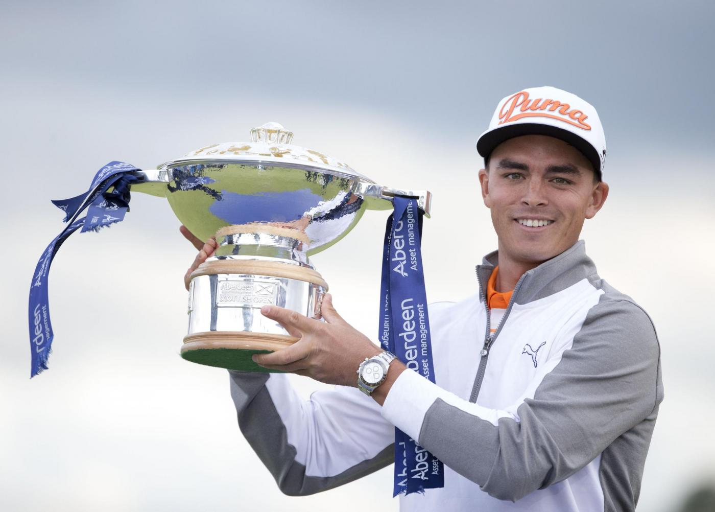 USA's Rickie Fowler celebrates with the trophy after winning the Scottish Open at Gullane Golf Club, East Lothian. PRESS ASSOCIATION Photo. Picture date: Sunday July 12, 2015. See PA story GOLF Gullane. Photo credit should read: Kenny Smith/PA Wire. RESTRICTIONS: Editorial use only. No commercial use. No false commercial association. No video emulation. No manipulation of images.