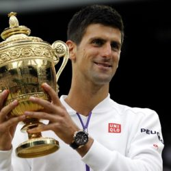 (150712) -- LONDON, July 12, 2015 (Xinhua) -- Novak Djokovic of Serbia poses with the trophy after the men's singles final with Roger Federer of Switzerland at the 2015 Wimbledon Championships in Wimbledon, southwest London, Britain on July 12, 2015. Novak Djokovic beat Roger Federer 3:1 to win the title. (Xinhua/Han Yan)