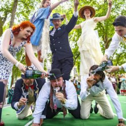 July 11, 2015 - London, London, UK - London, UK. Competitors forming a 'human champagne pyramid' at The Chap Olympiad in Bedford Square, London on July 11, 2015. The Chap Olympiad is a light-hearted social sporting event aimed at revisiting the fashions and pastimes of the polite aspects of 1920's to 1950's England. The Chap Olympiad: Le Olimpiadi dei Gentiluomini a Londra ZumaPressLaPresse  -- Only Italy
