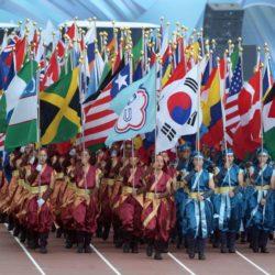 (150714) -- GWANGJU, July 14, 2015 (Xinhua) --   Volunteers holding national flags march into the Gwangju World Cup Stadium during the closing ceremony of 2015 Summer Universiade in Gwangju, South Korea, on July 14, 2015.(Xinhua/Tao Xiyi)(wll)