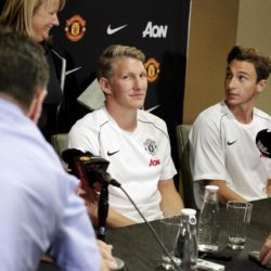Soccer players Bastian Schweinsteiger (2nd L) and Matteo Darmian (R) are seated as Manchester United introduces three new signings, Schweinsteiger, Darmian and Morgan Schneiderlin, at a news conference in Bellevue, Washington July 15, 2015.  REUTERS/Jason Redmond