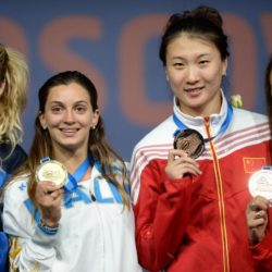 Siver medalist Emma Samuelsson, gold medalist Rossella Fiamingo, bronze medalists Xu Anqi of China and Sarra Besbes of Tunisia (L-R) pose during awarding ceremony of women's epee at World Fencing Championships in Moscow, Russia, Jul. 15, 2015 (Xinhua/ Pavel Bednyakov)