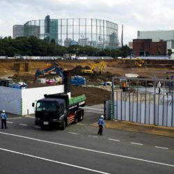 A truck leaves the construction site of Japan's new National Stadium in Tokyo July 17, 2015. Japan's new National Stadium has been ditched as the main venue for the 2019 Rugby World Cup because its proposed design will be scrapped to cut costs and it won't be ready in time, Prime Minister Shinzo Abe said on Friday. REUTERS/Thomas Peter