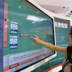 "(150717) -- SHANGHAI, July 17, 2015 (Xinhua) -- A visitor experiences a ""touching blackboard"" during the Mobile World Congress Shanghai in Shanghai, east China, July 17, 2015. The Mobile World Congress Shanghai was held here from July 15 to July 17.  (Xinhua/Liu Xiaojing) (zwx)"