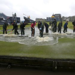 Course officials clear standing water as rain suspends play during day two of The Open Championship 2015 at St Andrews, Fife. PRESS ASSOCIATION Photo. Picture date: Friday July 17, 2015. See PA story GOLF Open. Photo credit should read: Danny Lawson/PA Wire. RESTRICTIONS: Editorial use only - no commercial use. No onward sale. Still image use only. The Open Championship logo and clear link to The Open website (www.TheOpen.com) to be included on website publishing. Call +44 (0)1158 447447 for further info. Lapresse Only italyGolf - The Open Championship 2015 - Secondo giorno