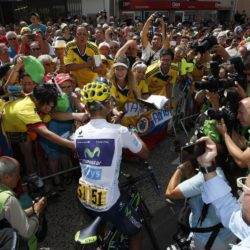Movistar rider Nairo Quintana of Colombia signs autographs before the start of the 198.5-km (123.3 miles) 13th stage of the 102nd Tour de France cycling race from Muret to Rodez, France, July 17, 2015. REUTERS/Eric Gaillard