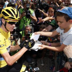 Team Sky rider Chris Froome of Britain, race leader's yellow jersey, signs autographs to supporters before the start of the 198.5-km (123.3 miles) 13th stage of the 102nd Tour de France cycling race from Muret to Rodez, France, July 17, 2015. REUTERS/Benoit Tessier   ATTENTION EDITORS : FRENCH LAW REQUIRES THAT THE FACES OF MINORS ARE MASKED IN PUBLICATIONS