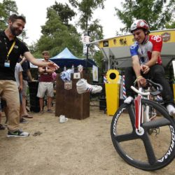 An artist performs on his bicycle at the riders village before the start of the 198.5-km (123.3 miles) 13th stage of the 102nd Tour de France cycling race from Muret to Rodez, France, July 17, 2015. REUTERS/Benoit Tessier