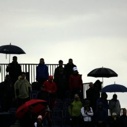 A silhouetted view as spectators watch the first groups of the day from under umbrellas during day four of The Open Championship 2015 at St Andrews, Fife. PRESS ASSOCIATION Photo. Picture date: Sunday July 19, 2015. See PA story GOLF Open. Photo credit should read: Danny Lawson/PA Wire. RESTRICTIONS: Editorial use only - no commercial use. No onward sale. Still image use only. The Open Championship logo and clear link to The Open website (www.TheOpen.com) to be included on website publishing. Call +44 (0)1158 447447 for further info.