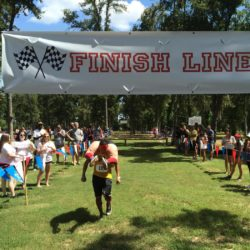 (150719) -- HOUSTON, July 19, 2015 (Xinhua) -- Participants take part in the Wife Carrying Championship in Houston, the United States, July 18, 2015. The 4th annual Texas Wife Carrying Championship was held in Houston on Saturday, attracting hundreds of spectators. A total of 60 couples joined the race to finish an obstacle course of 277 yards. (Xinhua/Zhang Yongxing)