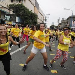 Health enthusiasts dance to high tempo music as they  participate in a Guinness World Records attempt for the largest Zumba class held along the main streets of Mandaluyong city, metro Manila, July 19, 2015. Mandaluyong city achieved the Guinness World Records for the largest Zumba class with an official tally of 12,975 people simultaneously doing Zumba, overthrowing Cebu City's record of 8,232 people held in October 2014, a Guinness World Records official said.      REUTERS/Lorgina Minguito