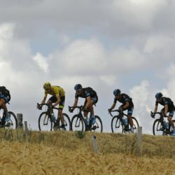 Team Sky rider Chris Froome of Britain (2ndL) wears the the overall leader's yellow jersey as he cycles with his team mates during the 183-km (113.71 miles) 15th stage of the 102nd Tour de France cycling race from Mende to Valence, France, July 19, 2015.  REUTERS/Stefano Rellandini
