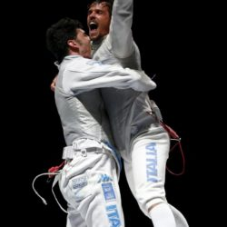 Italy's Andrea Baldini (R) celebrates with team mate Andrea Cassara after their victory over team Russia in the men's team foil final at the World Fencing Championships in Moscow, Russia, July 19, 2015.  REUTERS/Grigory Dukor