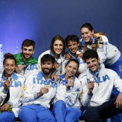 Italian fencers, winners of the men's and women's team foil competitions, pose for a picture after a medal ceremony at the World Fencing Championships in Moscow, Russia, July 19, 2015. REUTERS/Grigory Dukor