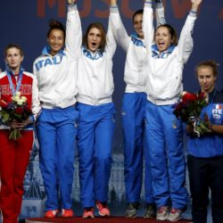 Winners of the women's team foil competition (L-R) Italy's Elisa Di Francisca, Arianna Errigo, Martina Batini and Valentina Vezzali celebrate on the podium during a medal ceremony at the World Fencing Championships in Moscow, Russia, July 19, 2015. REUTERS/Grigory Dukor
