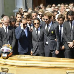 Formula One drivers Jean-Eric Vergne (4thR) and Felipe Massa (C), friends and relatives gather around the coffin of late Marussia F1 driver Jules Bianchi during the funeral ceremony at the Sainte Reparate Cathedral in Nice, France, July 21, 2015. Bianchi, 25, died in hospital in Nice on Friday, nine months after his crash at Suzuka in Japan and without regaining consciousness.   REUTERS/Jean-Pierre Amet