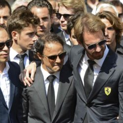 Formula One drivers Jean-Eric Vergne (2ndR) and Felipe Massa (2ndL), friends and relatives gather around the coffin of late Marussia F1 driver Jules Bianchi during the funeral ceremony at the Sainte Reparate Cathedral in Nice, France, July 21, 2015. Bianchi, 25, died in hospital in Nice on Friday, nine months after his crash at Suzuka in Japan and without regaining consciousness.   REUTERS/Jean-Pierre Amet