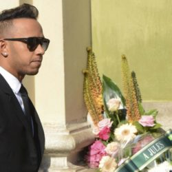 Formula One driver Lewis Hamilton arrives to attend the funeral ceremony for late Marussia F1 driver Jules Bianchi at the Sainte Reparate Cathedral in Nice, France, July 21, 2015. Bianchi, 25, died in hospital in Nice on Friday, nine months after his crash at Suzuka in Japan and without regaining consciousness.   REUTERS/Jean-Pierre Amet