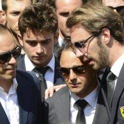 Formula One drivers Jean-Eric Vergne (R) and Felipe Massa C), friends and relatives gather around the coffin of late Marussia F1 driver Jules Bianchi during the funeral ceremony at the Sainte Reparate Cathedral in Nice, France, July 21, 2015. Bianchi, 25, died in hospital in Nice on Friday, nine months after his crash at Suzuka in Japan and without regaining consciousness.   REUTERS/Jean-Pierre Amet