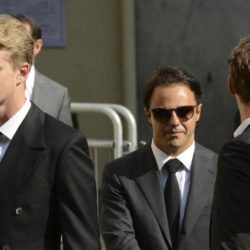 Formula One drivers Nico Hulkenberg (L) and Felipe Massa (C) arrive to attend the funeral ceremony of late Marussia F1 driver Jules Bianchi at the Sainte Reparate Cathedral in Nice, France, July 21, 2015. Bianchi, 25, died in hospital in Nice on Friday, nine months after his crash at Suzuka in Japan and without regaining consciousness.   REUTERS/Jean-Pierre Amet