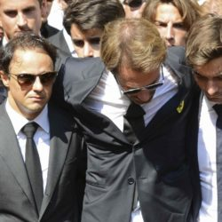 Formula One drivers Jean-Eric Vergne (C) and Felipe Massa (L), friends and relatives gather around the coffin of late Marussia F1 driver Jules Bianchi after the funeral ceremony at the Sainte Reparate Cathedral in Nice, France, July 21, 2015. Bianchi, 25, died in hospital in Nice on Friday, nine months after his crash at Suzuka in Japan and without regaining consciousness.   REUTERS/Jean-Pierre Amet