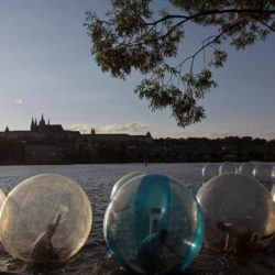 People play inside giant plastic balls, called Zorb on the Vltava river as temperatures hovered over 34 degrees Celsius (93 degrees Fahrenheit) in Prague, Czech Republic, July 21, 2015.  REUTERS/David W Cerny